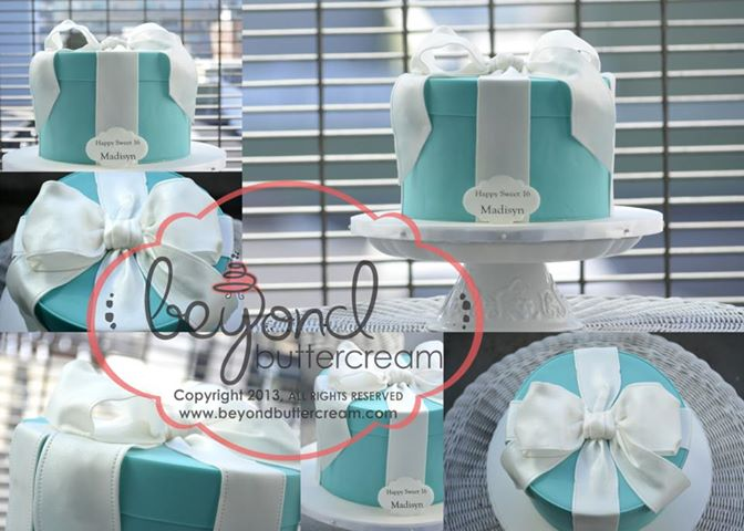 Beyond Tiffanys themed present cake This is a fresh strawberry cake with strawberry buttercream covered in teal fondant with a fondant bow and 100% edible! Even the plaque that is printed on her edible image printer.
