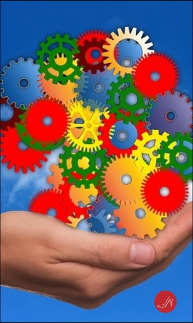 Hand holding colored gears