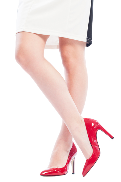 Women legs wearing white skirt and red shoes- business casual dress code
