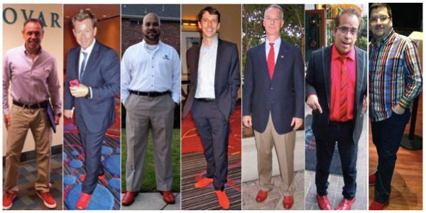 Discover how engaging men in your career will take you to the next level! Men wearing red shoes to show support for women's career success