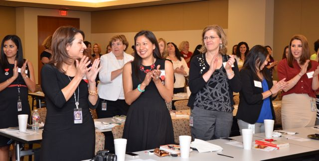 Latina speaker elicits reaction from audience at Tesoro Corporation | Audience reaction to keynote presentation at Tesoro Corporation, event organized by NSHMBA