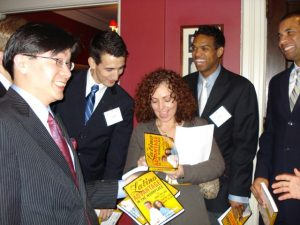Mariela Dabbah, Hispanic Motivational Speaker, signs books at Harvard Business Club