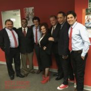 At an in-house leadership training for Novartis Andean Region, men show up in red ties, socks and shoes to openly show support for women's career growth.