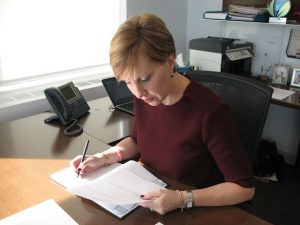 Deborah Gillis at her desk