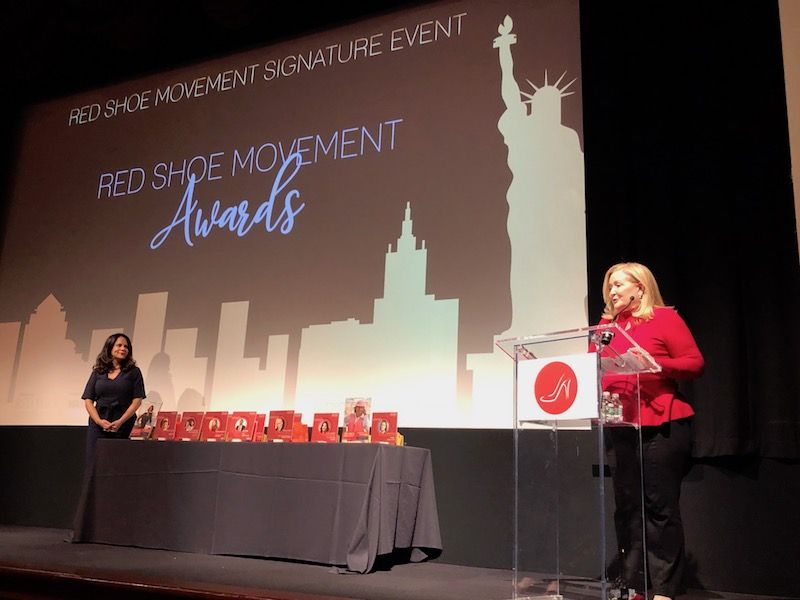 Cynthia Hudson welcomes the Red Shoe Movement audience to Awards Ceremony
