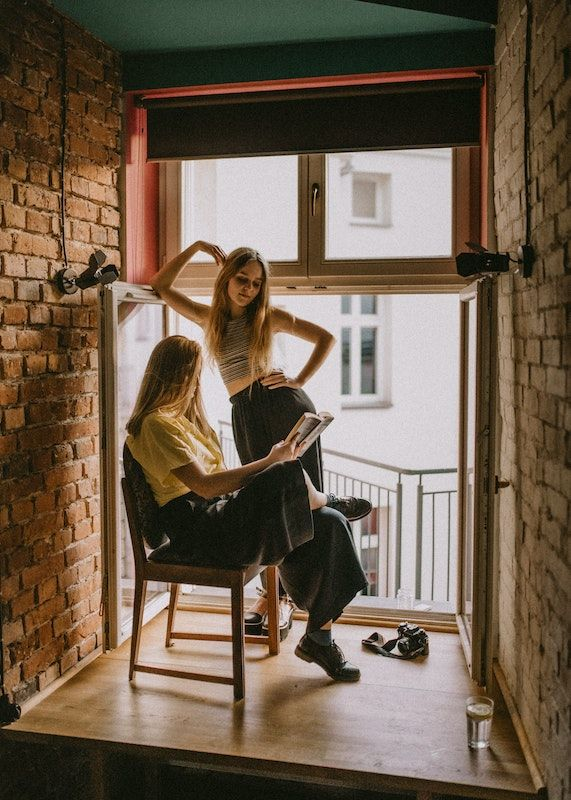 Reading out loud during the quarantine can help you spend quality time together. Photo Credit- Kinga Cichewicz. Unsplash